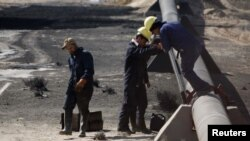 Work on a damaged pipeline in Iraq's Al-Basrah province in December