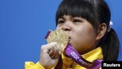 Ауыр атлетикадан олимпиада чемпионы Зүлфия Чиншанло. Лондон, 29 шілде 2012 ж.