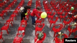 Children place flowers and balloons on chairs in Sarajevo in April 2012 to honor more than 11,000 children killed in the Bosnian war.