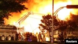 На месте железнодорожной катастрофы в канадской провинции Квебек, 6 июля 2013 г.