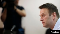 Opposition leader and anticorruption blogger Aleksei Navalny attends a court hearing in Moscow on August 14.