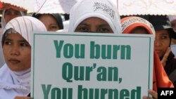 A group of Indonesian demonstrators belonging to the Hizb ut-Tahrir, an Islamist organization, protested against the Florida church's Koran-burning plan in Jakarta on September 4.