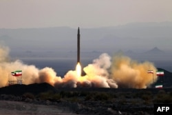 A 2010 photograph shows the test-firing in Iran of a surface-to-surface Qiam missile.