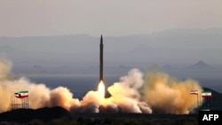 A picture released by Iranin Defence Ministry on August 20, 2010 shows the test firing at an undisclosed location in Iran of a surface-to-surface Qiam missile, entirely designed and built domestically and powered by liquid fuel.