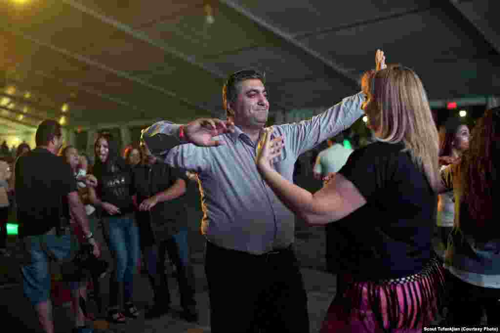 "Dancing at SummerFest, an annual party organized by the Armenian Community Center in Toronto, Canada. ""Toronto is a city that accepts people from all over the world and all walks of life with open arms,"" a local told Tufankjian. ""Ever since I was little 'being Armenian' has just been a natural part of my life."""