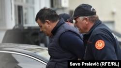 U jednoj od rijetkih akcija protiv trafikanata, crnogorska policija presjekla lanac krijumčarenja migranata; fotografija sa privođenja