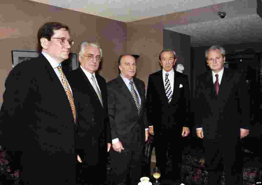 Delegates pose before the Balkan peace talks, on October 31, 1995, near Dayton, Ohio. From left to right: Richard Holbrooke, U.S. Assistant Secretary for European and Canadian Affairs; Franjo Tudjman, President of Croatia; Alija Izetbegovic, President of Bosnia-Herzegovina; Warren Christopher, U.S. Secretary of State; Slobodan Milosevic, President of Serbia.