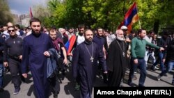 Armenia -- Priests lead marching opposition protesters in Yerevan, 22 April 2018.
