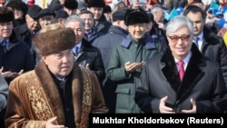 Нурсултан Назарбаев (слева) и Касым-Жомарт Токаев (справа) на праздновании Наурыза в Астане. 21 марта 2019 года.