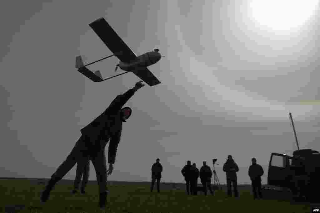 A Ukrainian serviceman launches an unmanned reconnaissance aircraft near the eastern Ukrainian city of Lysychansk in the Luhansk region on March 24. (AFP/Petro Zadorozhnyy)