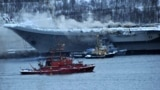 RUSSIA -- Smoke rises from Russia's only aircraft carrier, the Admiral Kuznetsov, in Murmansk, December 12, 2019