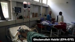 Afghan civilians injured in a suicide attack in the eastern Afghan city of Jalalabad are being treated in a local hospital in Jalalabad on September 11.