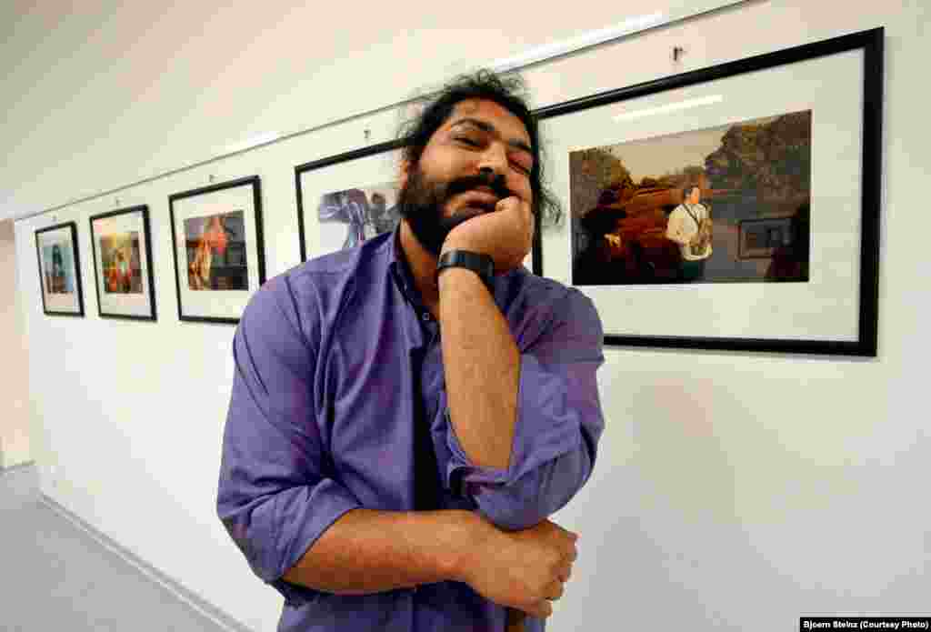 Bihari poses in front of his photographs at an exhibition in Ostrava, Czech Republic.