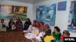 Tajikistan --- Tajik women are sewing national closes, Shahrtuz, region in southern Tajikistan, 2006