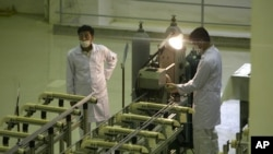 Technicians work at a new facility producing uranium fuel for a planned heavy-water nuclear reactor, just outside the city of Isfahan in Iran. (file photo)