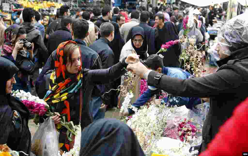 Iranians buy flowers for Norouz celebrations at a street market in Tehran.