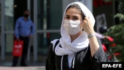 Face masks are now commonplace on the streets of Tehran as the Islamic republic continues to battle the MIddle East's deadliest outbreak of COVID-19.