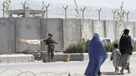 A soldier keeps watch outside Kandahar's main jail.