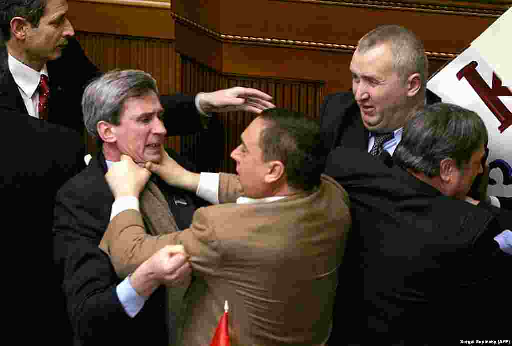 Deputies of Ukraine's parliament going at it before the annual speech by then Ukrainian President Viktor Yushchenko in February 2006. The fighting erupted after Communist Party members attempted to attach a placard to the speaker's platform.