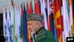 Afghan President Hamid Karzai arrives at the start of the Afghanistan conference in Bonn on December 5.