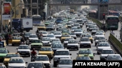 A picture taken on September 12, 2015 shows Iranians driving in heavy traffic in the capital Tehran.
