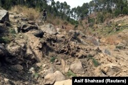 A Pakistani soldier near a crater allegedly left by an Indian air strike in Pakistan's Balakot region. Photo taken on February 28.