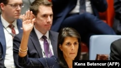 U.S. -- U.S. Ambassador to the United Nations Nikki Haley rises her arm as she votes at a U.N. Security Council meeting over North Korea's new sanctions at the U.N. Headquarters in New York, September 11, 2017