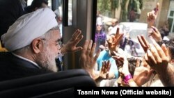 Hassan Rohani greets supporters