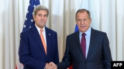 U.S. Secretary of State John Kerry (left) shakes hands with Russian Foreign Minister Sergei Lavrov on August 26 in Geneva.