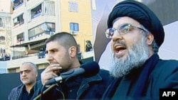 A TV grab shows Hizballah leader Sheikh Hassan Nasrallah delivering a speech in southern Beirut on December 6.