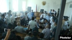 Armenia -- A chaotic scene at the trial of arrested members of an armed opposition group in Yerevan, 28 June, 2017.