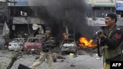 Pakistani policemen arrive at the site of a bomb explosion in Lahore on February 17.