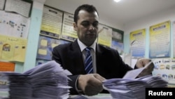 An Egyptian official counts ballots after polls closed in a 2012 vote.