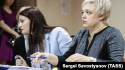 Flight attendant Yevgenia Magurina (right) attends the court hearing in Moscow on April 21.