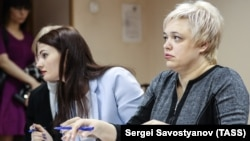 Yevgenia Magurina (right) attends a court hearing in Moscow in April.