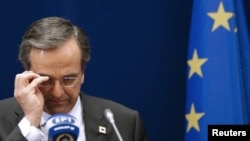 Greek Prime Minister Antonis Samaras adjusts his glasses at a two-day EU leaders summit in Brussels in October, 2012.