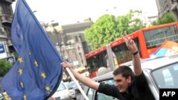 A man waves an EU flag in Belgrade after Serbia signed the bloc's Stabilization and Assocation Agreement in 2008.