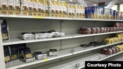 Empty supermarket shelves show the frenzied buying of macaroni by Iranians. May 5, 2019