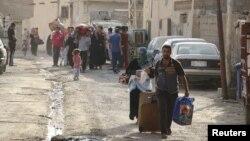 سكان الرمادي يغادرون المدينة هربا من ارهاب داعش