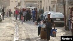 Ramadinin sünni əhalisi İD qüvvələrinin hücumu zamanı şəhəri tərk ediblər.
