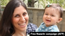 Iranian-British Nazanin Zaghari-Ratcliffe poses for a photograph with her daughter Gabriella, undated