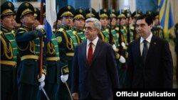 Turkmenistan- Turkmenistan's President Gurbanguly Berdimuhamedov and his visiting Armenian counterpart Serzh Sarkisian inspect an honor guard in Ashgabat,8Apr2014.