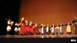 Macedonian folk dancers in folk costumes.