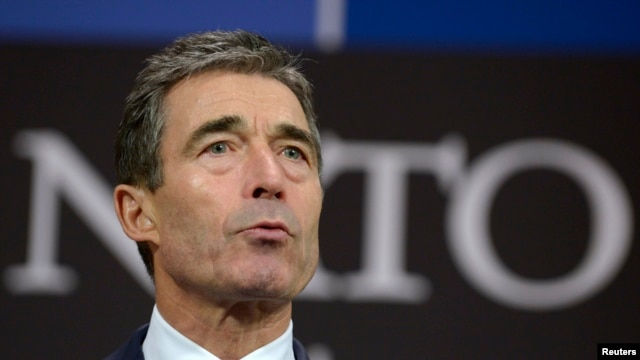 NATO Secretary-General Anders Fogh Rasmussen addresses a news conference during a NATO defense ministers' meeting at alliance headquarters in Brussels on February 21.