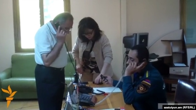Armenia - Officials at the Vanadzor branch of the Rescue Service answer phone calls from anxious residents after an earthquake, 7Jul2014.