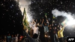 Supporters of Nawaz Sharif celebrate with fireworks in Lahore on May 12.