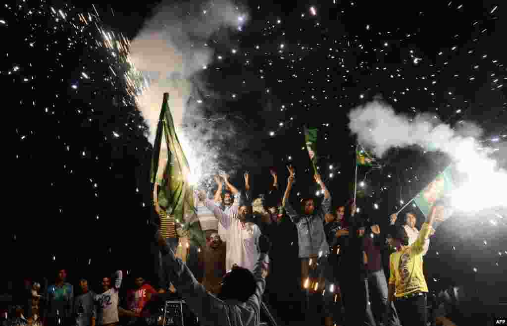 Supporters of Nawaz Sharif of the Pakistan Muslim League-N (PML-N) celebrate their party's victory in Lahore on May 12, a day after the country's general elections secured Sharif a third non-consecutive term as prime minister.