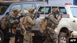 French special forces take position in the surroundings of the Splendid hotel following an attack by Al-Qaeda linked gunmen on January 16 in Ouagadougou.
