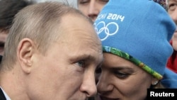 Russian President Vladimir Putin with Olympic Village Mayor Yelena Isinbayeva in Sochi on February 5, 2014.