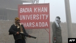Pakistani security personnel stand near Bacha Khan University in Charsadda on January 25.